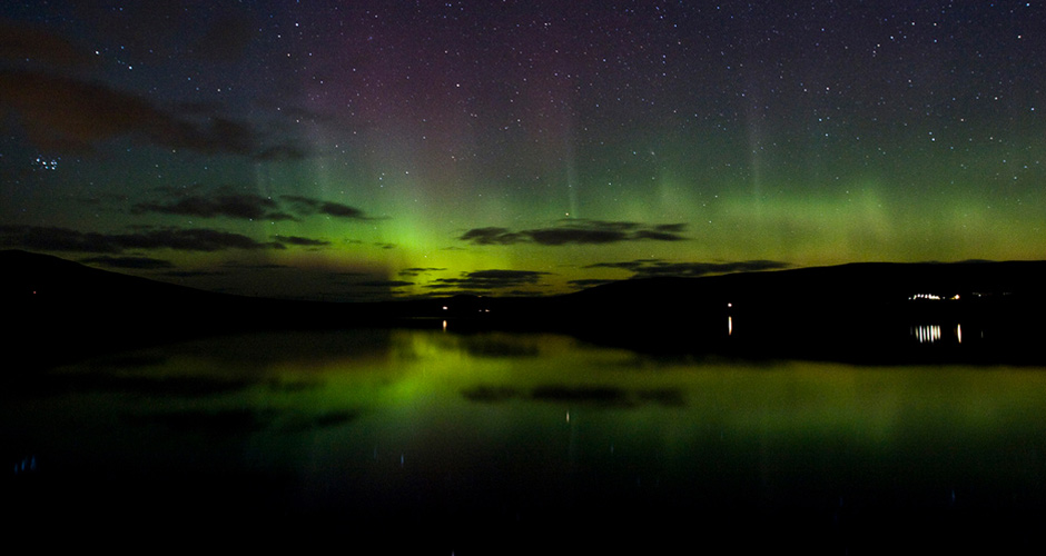 Northern lights over the Kirbister Loch by John Wishart